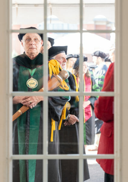 Dr. Cundari leads students into Commencement