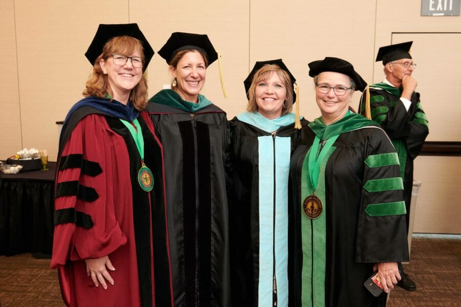 COMP-Northwest faculty posing for a photo prior to the ceremony