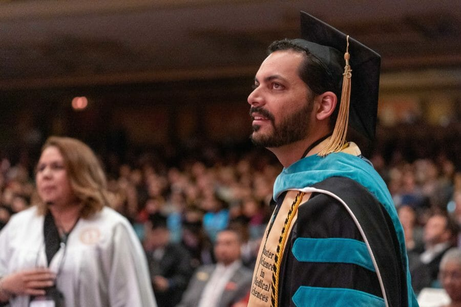 OD Alumni Representative looking toward stage during the hooding ceremony